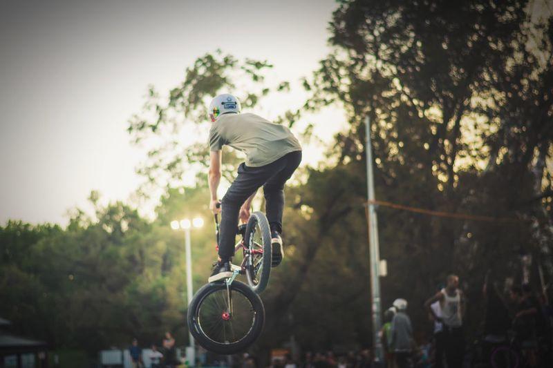 Boy Performing Stunts On Bicycle