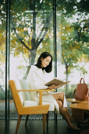 White coat Lady White Coat Shorthair Minimalism Fashion Quiet Moments Sitting Reading Waiting Window Indoors  Investing In Quality Of Life Paint The Town Yellow