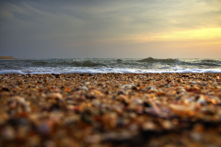 Sunset on the beach Beach Beauty In Nature EyeEm EyeEm Best Shots EyeEm Team Horizon Over Water Motion Nature No People Outdoors Pebble Rock - Object Sand Scenics Sea Sky Sunset Sunset_collection Surf Tranquil Scene Travel Travel Photography Vacations Water Wave