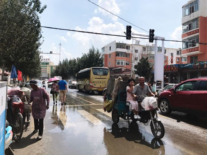 Architecture Built Structure Building Exterior Sky Car Real People Men Road Transportation Street Cloud - Sky Land Vehicle Large Group Of People Wet Day City Women Outdoors Tree People