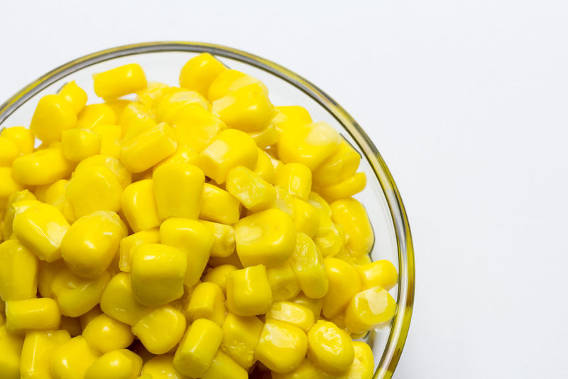 delicious canned sweet corn Cereal, Vegetable, Grain, Seeds, Corn, Corn, Sweet, Tender, Juicy, Tasty, Healthy, Ingredient, Preserved, Bowl, Cob, Steel, Canning. Packaging, Canned, Vegetarian, Vegan, Yellow, Isolated, White Background Abundance Bowl Close-up Container Corn Directly Above Food Food And Drink Freshness Healthy Eating High Angle View Indoors  Large Group Of Objects No People Still Life Studio Shot Sweetcorn Temptation Vegetable Wellbeing White Background Yellow