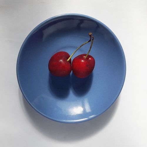 Directly above shot of cherries in bowl