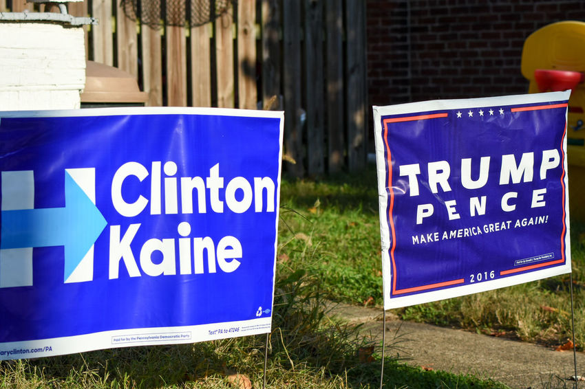 Domestic Dispute. Text Communication Sign Capital Letter Message Close-up Sign Board Signboard Outdoors Focus On Foreground Information Sign Politics Political Political Signs Political Sign Clinton Hillary Clinton Trump Donald Trump Democracy Republic Democrat Republican Disagreements Disagree