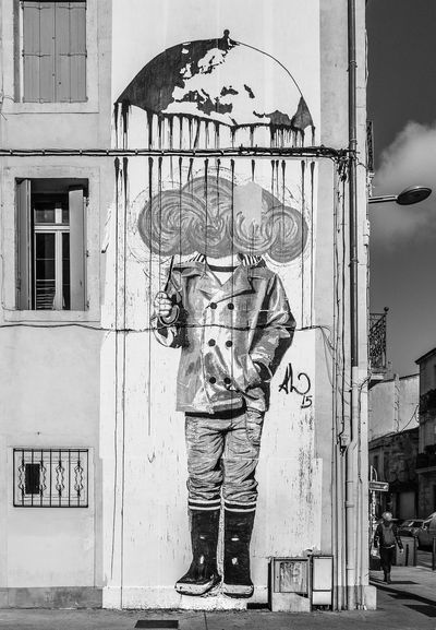 Built Structure Building Exterior Architecture City Outdoors One Person Embrace Urban Life Abstractart Clear Sky EyeEm Gallery EyeEm Best Shots Blackandwhite TakeoverContrast Black And White Monochrome ArtWork Creativity Streetart Graffiti Art Graffiti Montpellier Sticker Umbrella