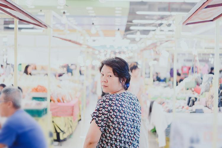 Portrait of woman standing in market