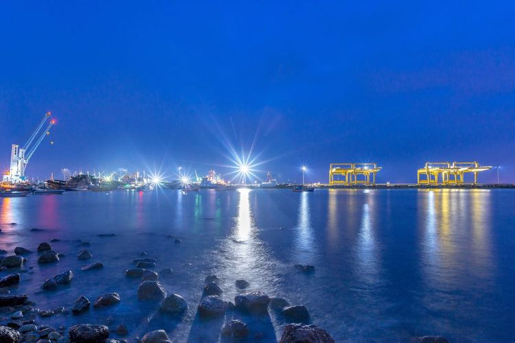 Night port Port Water Night Reflection Blue Sky Illuminated Industry Nature Sea Architecture No People Waterfront Built Structure Transportation Outdoors Business Finance And Industry Beauty In Nature Nautical Vessel Building Exterior