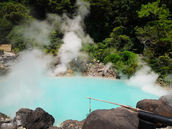 High angle view of steam emitting from hot spring