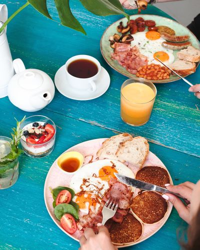 Breakfast Drink Eating Utensil Food Food And Drink Freshness Glass Hand Healthy Eating High Angle View Holding Human Body Part Human Hand Indoors  Meal Meat One Person Plate Ready-to-eat Real People Refreshment Table Temptation