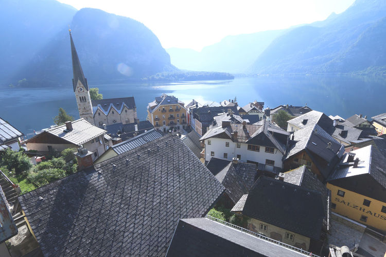 Beautiful town of Hallstatt by the lake in Austria Austria Church Light Rays Morning Salzkammergut Travel UNESCO World Heritage Site Beauty In Nature Europe Hallstatt Heritage Lakeside Mountain Popular Scenery Scenics - Nature Tour Tourism Town Water