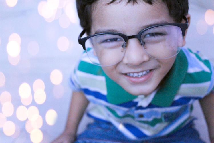 Portrait of smiling cute boy wearing eyeglasses