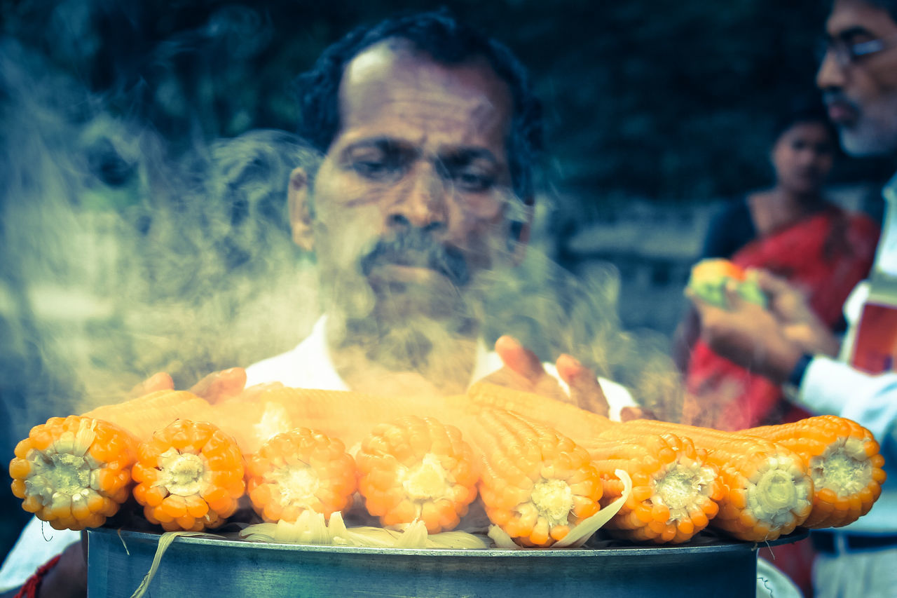 food and drink, food, smoke - physical structure, barbecue, burning, real people, heat - temperature, focus on foreground, outdoors, men, freshness, close-up, healthy eating, ready-to-eat, day, one person, people
