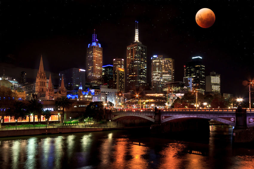 Super Blue Blood Moon rises over the Melbourne CBD Red Architecture Blood Moon Building Exterior Built Structure City City Life Cityscape Illuminated Modern Night No People Outdoors River Sky Skyscraper Super Blue Blood Moon Tall - High Tower Travel Destinations Urban Skyline Water