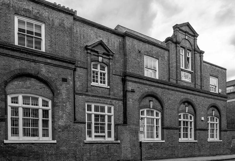 Old School Building In Clerkenwell Against Sky