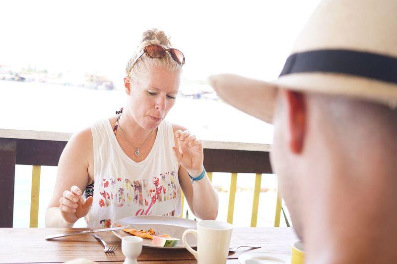 Woman eating food at restaurant