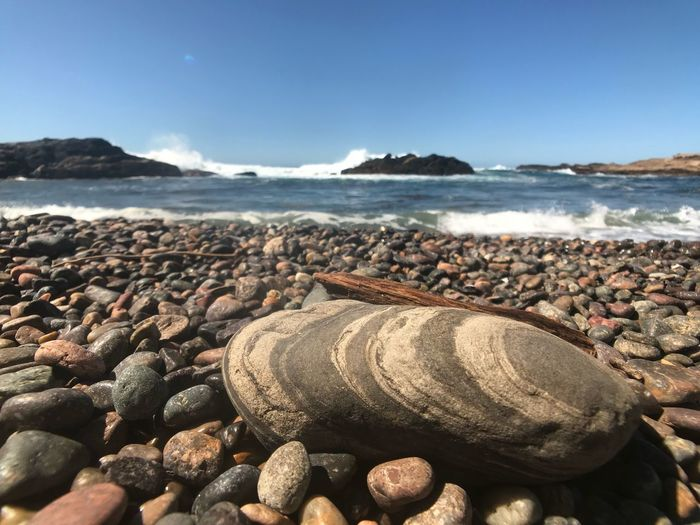 Water Sea Beach Land Rock Sky Solid Day Nature No People Rock - Object Wave Sunlight Stone - Object Outdoors Tranquility Tranquil Scene Beauty In Nature Scenics - Nature Stone