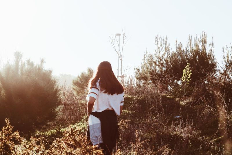 Rear View One Person Real People Casual Clothing Long Hair Standing Fashion Stories Leisure Activity Women Full Length Lifestyles Nature Tree Plant Young Women Day Clear Sky Outdoors Young Adult