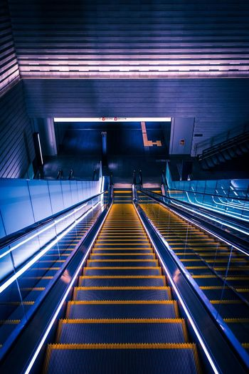 Color Surge Looking Down Abstract Still Life Escalator Futuristic Tokyo Japan Neo Tokyo Cyberpunk Tech Architecture Transportation Illuminated Built Structure Railing Indoors  Escalator Staircase Public Transportation Lighting Equipment Technology High Angle View The Architect - 2019 EyeEm Awards