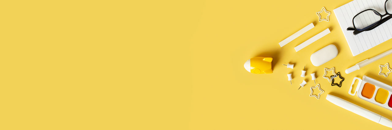 Low angle view of yellow lights against orange background