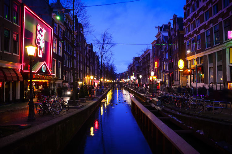 Amsterdam Canal in January. Amsterdam Amsterdam Canal Amsterdam Centraal Amsterdamcity Architecture Bike Bridge Bridge - Man Made Structure Building Exterior Built Structure Canal Dusk Illuminated Neon Lights Night No People Outdoors Red Light District Reflection Reflection River Riverside Travel Destinations View Water