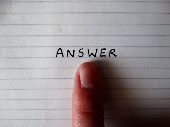 Pointing to the Answer. Text Communication Human Body Part Human Hand Page Close-up Paper Indoors  One Person Day People Note Notebook Word Words Finger Human Finger Point Pointing Answer Find