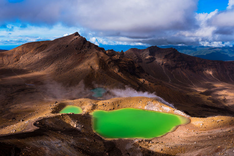 Beautiful Emerald Lakes in Tongariro National Park Green Tongariro Crossing Travel Arid Climate Beauty In Nature Cloud - Sky Day Geology Lakes  Landscape Mountain Mountain Range Nature New Zealand No People Outdoors Remote Scenics - Nature Sky Tranquil Scene Tranquility Volcanic Crater Water