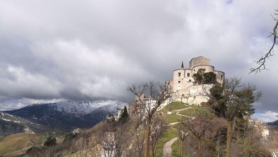 Il Borgo Piu Bello D'Italia Tree Landscape Castle Storm Cloud Amphitheater Snowcapped Mountain Thunderstorm Fortified Wall Civilization Snowcapped Forked Lightning Overcast Fortress Rocky Mountains Atmospheric Mood Medieval Zermatt Mountain Range Historic Weather Lightning Old Ruin Storm Snow Covered Fort