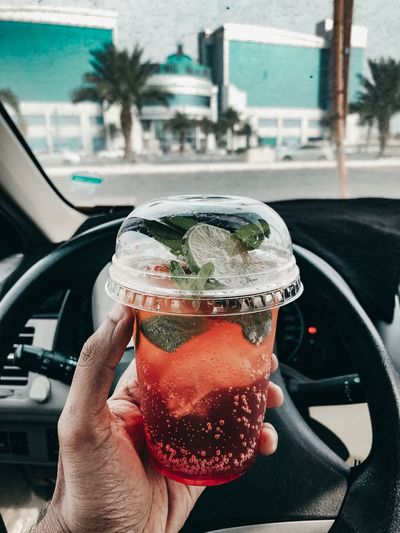 drink power Food And Drink Car Transportation Motor Vehicle Mode Of Transportation One Person Human Hand Hand Outdoors Lifestyles Vehicle Interior Car Interior Transparent Day Human Body Part Glass - Material Architecture Real People Land Vehicle Holding Close-up