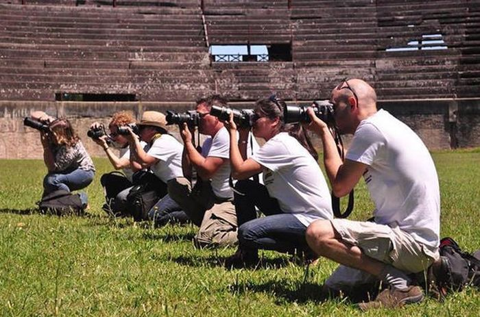 Photographers in action Group Of People Grass Adult Photography Themes People Sport Sitting Men Crowd Activity Lying Down Nature Relaxation Young Adult Males  Plant Field Technology Architecture Weapon