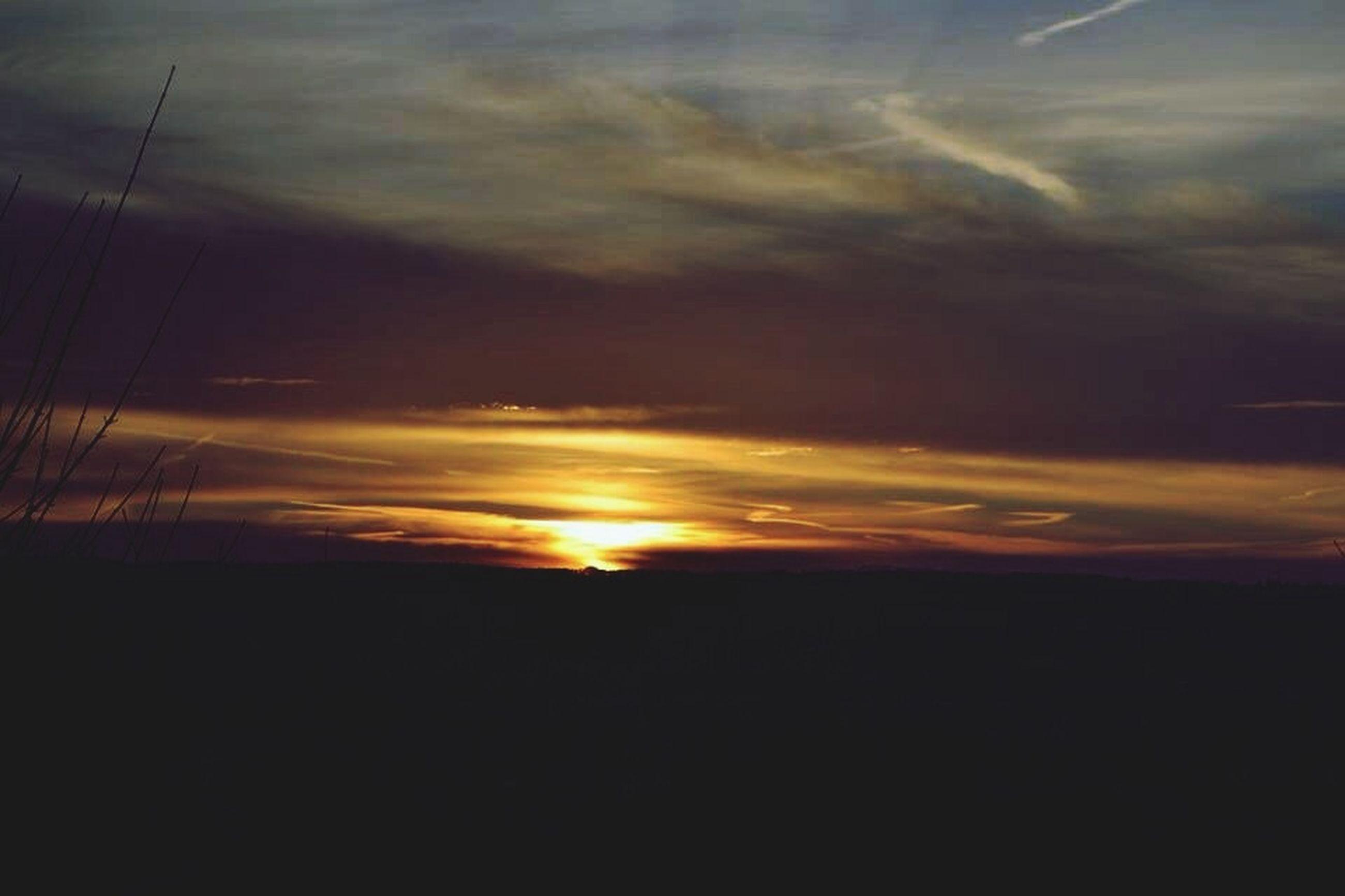 sunset, silhouette, scenics, sky, tranquil scene, sun, beauty in nature, tranquility, orange color, cloud - sky, landscape, idyllic, nature, sunlight, sunbeam, cloud, dramatic sky, outdoors, dark, no people