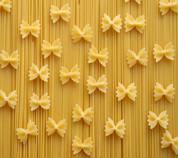 Full frame shot of farfalles on spaghetti pasta