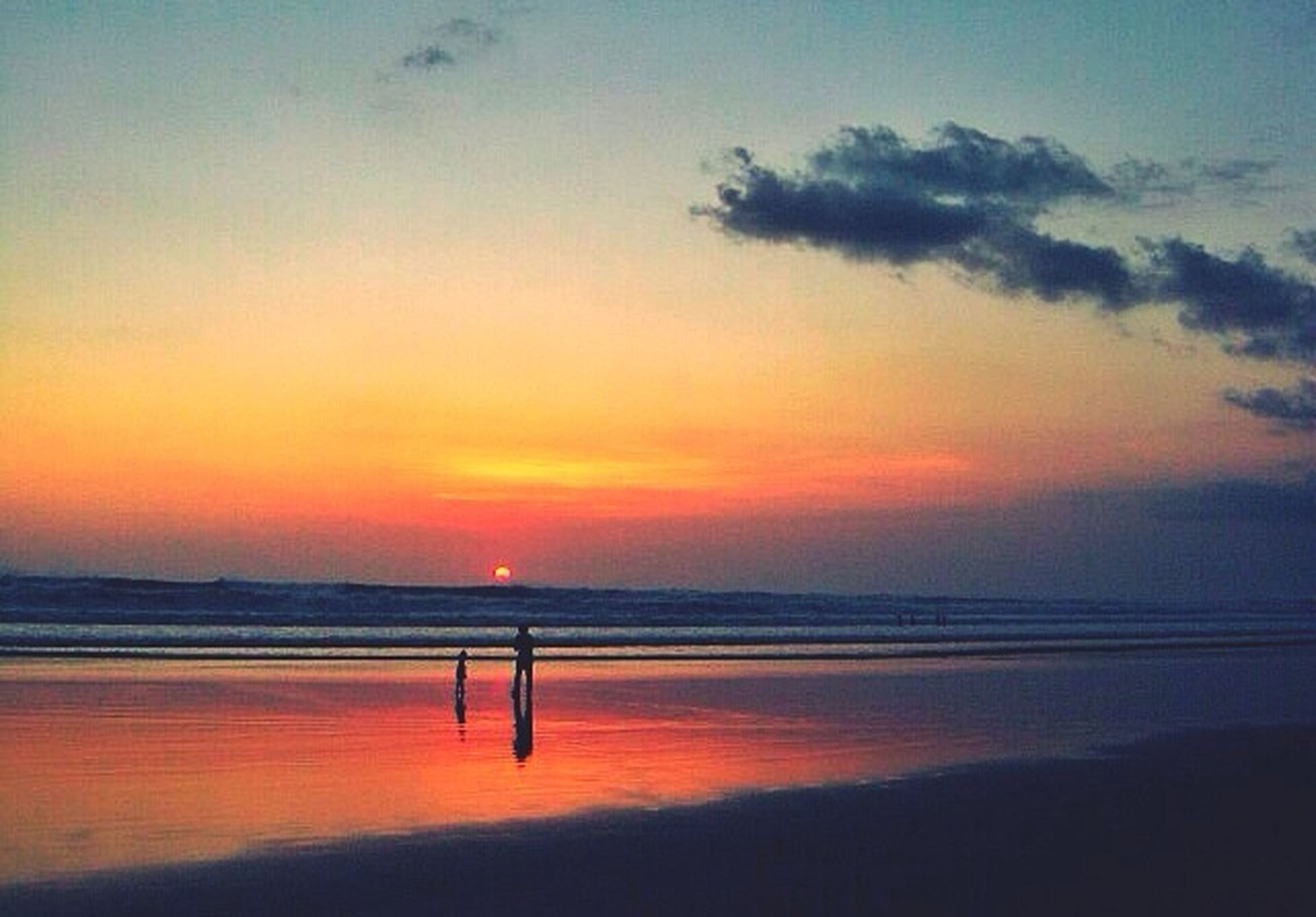 sea, sunset, horizon over water, water, beach, scenics, tranquil scene, tranquility, beauty in nature, orange color, sky, shore, silhouette, idyllic, nature, reflection, outdoors, remote, cloud - sky, calm