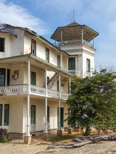 Colonial times building in Lobito, Angola. There are many reminders of Portuguese colonial rule to be found in the country. Angola Architecture Balcony View Home Houses Lobito Africa Architectural Column Architecture Balcony Building Exterior Built Structure Cloud - Sky Colonial Colonial Architecture Day House No People Outdoors Sky Tree