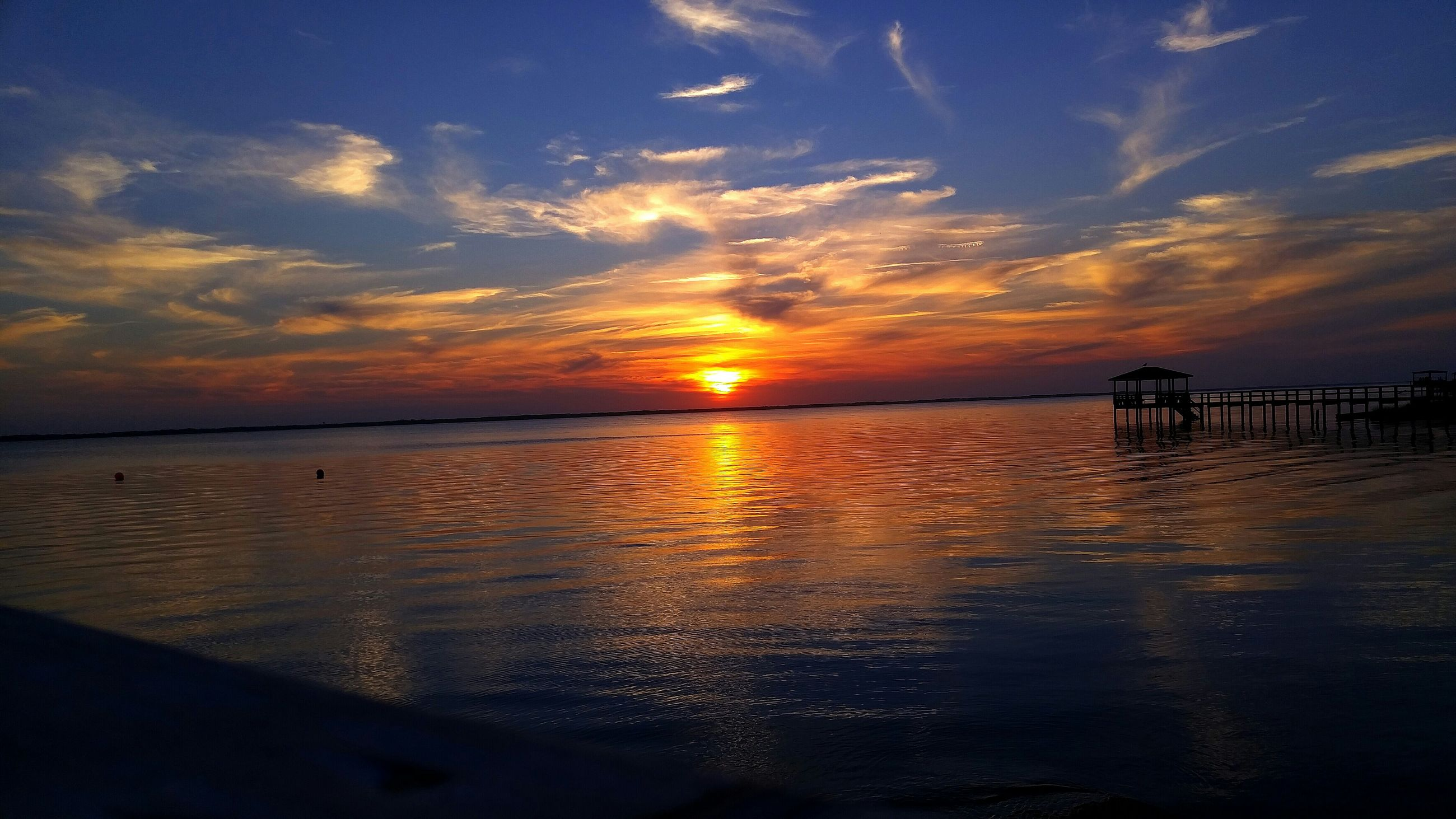 sunset, water, sea, tranquil scene, scenics, tranquility, sky, beauty in nature, horizon over water, sun, reflection, idyllic, orange color, beach, nature, cloud - sky, silhouette, shore, pier, cloud