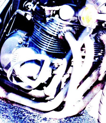 Motorcycle engine. Arty Photo. Blue Blue Colour. Close Up. Close-up Creative Photography. Design Detail. Edited. Engine. Part Of. Trike. Motorcycle. Car. Train. Gypsy Tag. Lettering. Art. Exhaust Pipes. Leisure Activity Motorcycle Engine. Motorcycle. Enjoying Life :) Multi Colored Part Of... Pipes. Metallic. Engine. Colourful. Creative.