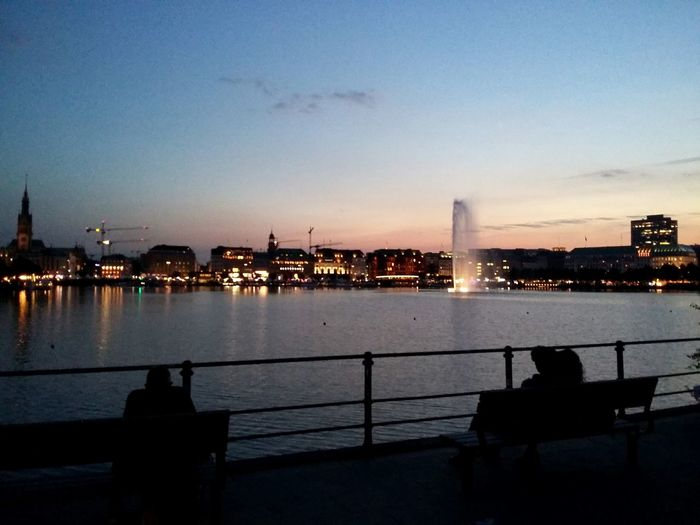 Hamburg Sunset. · Germany 040 Hamburgmeineperle Hansestadt Hanseatic City Lights Urban Landscape Skyline Alster Binnenalster Lake Golden Hour Light And Shadow Reflections People People Watching People On Benches Playing Tag