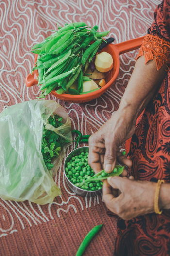 InMakin! Randomness Bag Selective Focus Coriander Bright Colors Old Hands Working Hands Human Body Part Human Hand Woman One Woman Only Vegetables Peas Celantro Turnip Basket Raw Food