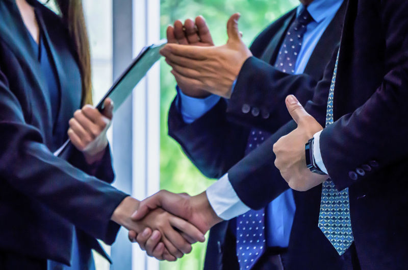 Midsection Of Entrepreneurs Shaking Hands