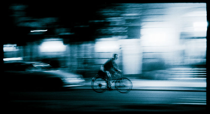 Cycling Unter den Linden. Analogue. Bicycle Motion Blurred Motion Ride Land Vehicle City Street Cycling Activity One Person Speed Outdoors Analogue Photography Filmphotography 35mmfilmphotography Streetphotography Streetphoto_bw Street Light Streetlife City Life
