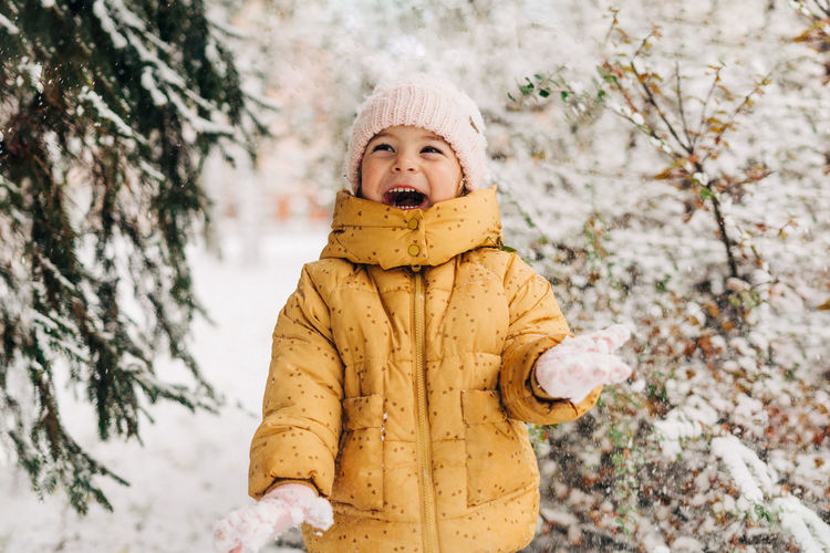 Portrait of a boy standing in snow