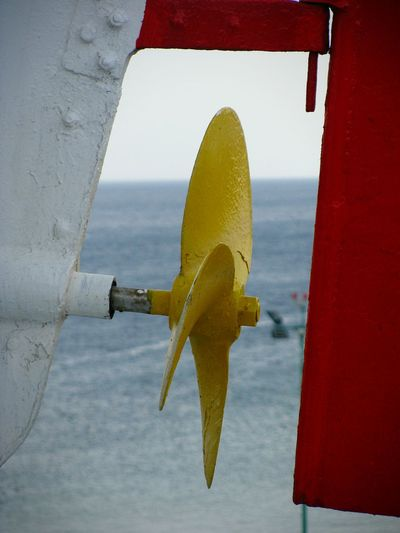 Propeller Yellow Yellow Propeller Propellers Boat Lifeboat Focus On Foreground Vibrant Color Sea Water Red Yellow And Red Painted Boat On A Ship