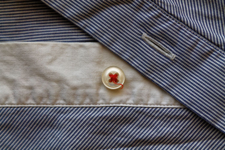 Directly Above Shot Of Button On Blue Striped Shirt