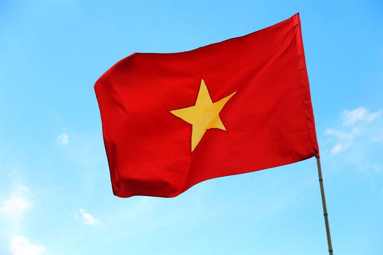 Large flag of Vietnam with yellow star and blue sky ASIA Asian  Hà Nội Hà Nội, Việt Nam Red Viet Nam Vietnam Vietnamese Flag Flags Freddom Hanoi Patriotism Red Sky Star Symbol Viet Nam Travel Vietnam Flag Vietnam Trip Weaving Yellow Star