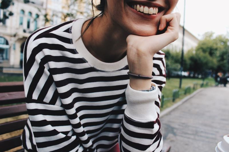 Smiley Striped One Person Casual Clothing Real People Day Leisure Activity Focus On Foreground Lifestyles Young Adult Women City Outdoors Adult Street Nature Young Women