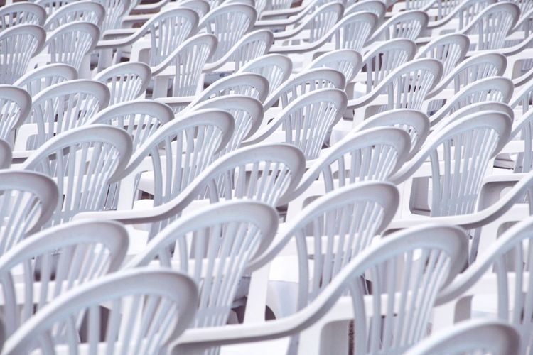 White chairs Curves Curves And Lines Curves And Shapes Event Pattern Plastic EyeEm Best Shots EyeEmNewHere Backgrounds Chair Full Frame In A Row Close-up Many Group White Auditorium Empty Theater Education Event