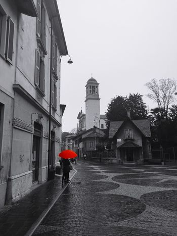 The rain is always cool with a bright umbrella.. Check This Out Streetphotography Streetphoto_bw Streetphoto_color Colorsplash People Peoplephotography Eye4photography  Urban Street Fashion