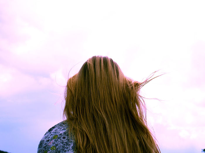 Beauty In Nature Brown Hair Carefree Cloud - Sky Green Color High Section Human Hair Long Hair Low Angle View Multi Colored Nature Person Rear View Sky