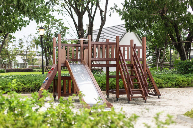 Relax Children Stairs Slides Playground equipment Plant Tree Day Nature Architecture No People Built Structure Wood - Material Park Outdoors Land Playground Growth Park - Man Made Space Empty Absence Green Color Building Exterior Tree Trunk Forest Outdoor Play Equipment Children Statue