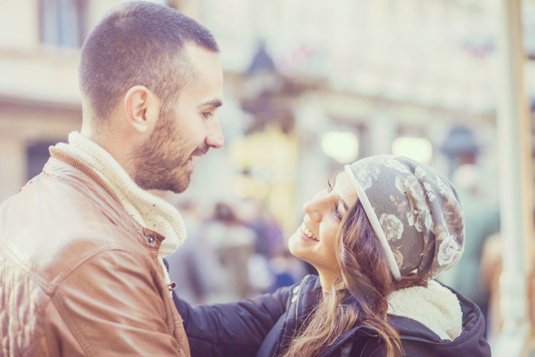 Young couple in love Shallow depth of field Beard Beautiful People Beauty Cheerful City City Life City Street Dating Enjoyment Flirting Happiness Heterosexual Couple Hipster - Person Lifestyles Love Males  Men Smiling Street Togetherness Two People Winter Women Young Adult Young Women