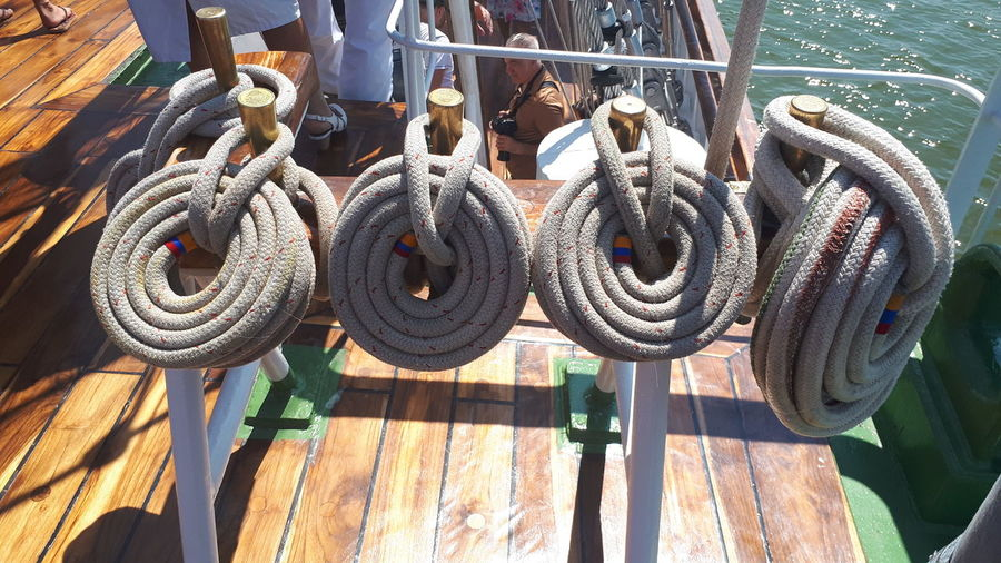 High angle view of ropes tied on metal