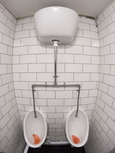 Fish-Eye Lens Of Urinals In Toilet